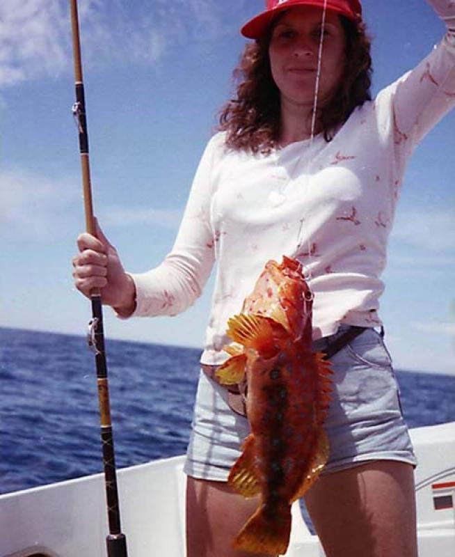 Harlequin Fish - Kim Booth with a Harlequin Fish that was caught while drifting off Safety bay in Western Australia. -SportfishWorld &copy Copyright 2003 All rights reserved