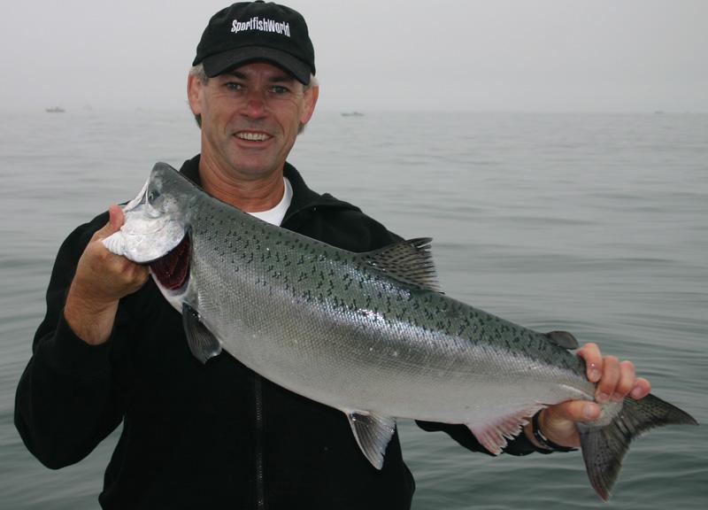 Salmon, King - Bob Fisher with a Duxbury Bouy Chinook (King) Salmon. Fishing with 12lb line on a baitcaster, mooching with live anchovies. Photo Tim McDaniel. -SportfishWorld &copy Copyright 2003 All rights reserved