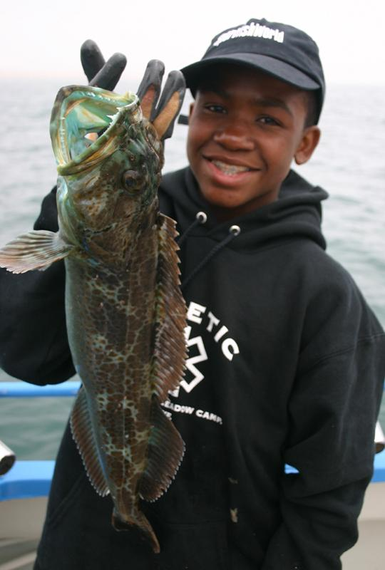 Ling, Green - Caleb Turner with a Green Ling caught up the coast, north of the Golden Gate Bridge, San Francisco California -SportfishWorld &copy Copyright 2003 All rights reserved