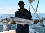 Fishing Port Hedland Fishing Photos  Spanish Mackeral Shehan with his first Port Hedland Mackie. Coxxon Shoals just at the back of the anchorage. Matt Evans. Bob Fisher's SportfishWorld &copy